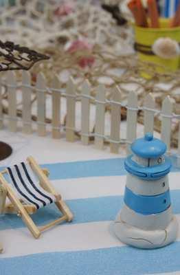 Idées deco de table de fêtes thème plage et bord de mer.